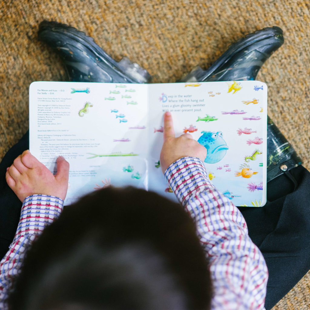 Child Reading Overhead