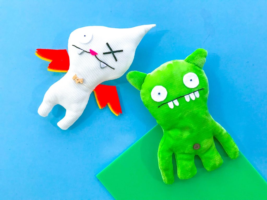 Flying Ugly Doll in Cloud with Green Ugly Doll